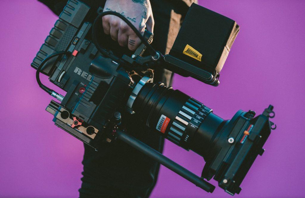 camera purple man holding video